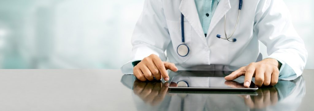 doctor with tablet - benefits of electronic health records