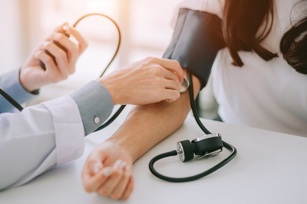 taking blood pressure - drop in primary care office visits