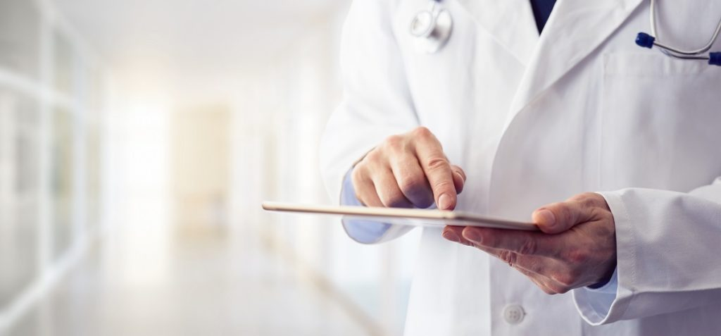 Doctor working on tablet - How technology helps the duties of a nurse
