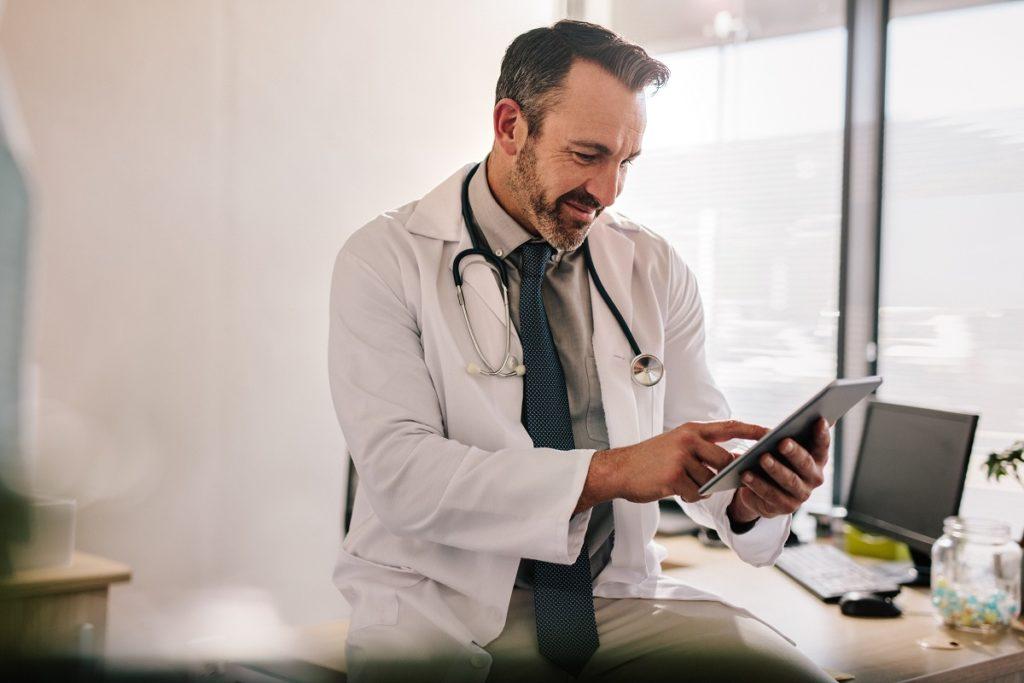 Doctor using tablet - EHR Implementation